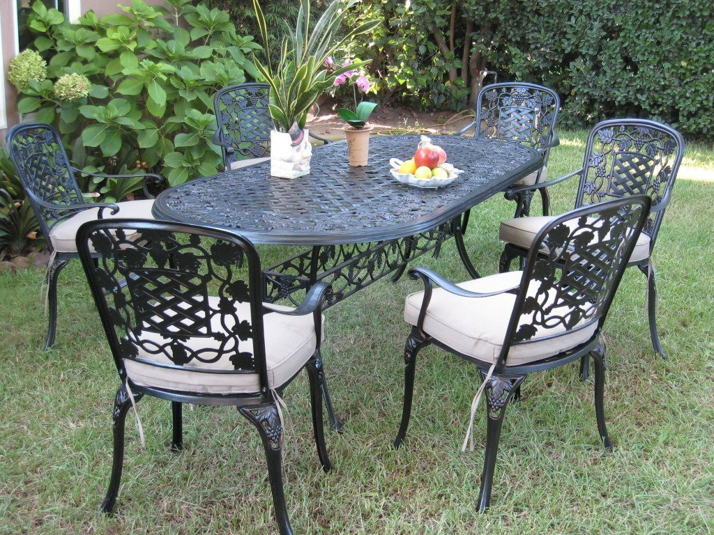 Outdoor cast aluminum 7 piece dining set with cushions for Patio furniture table set