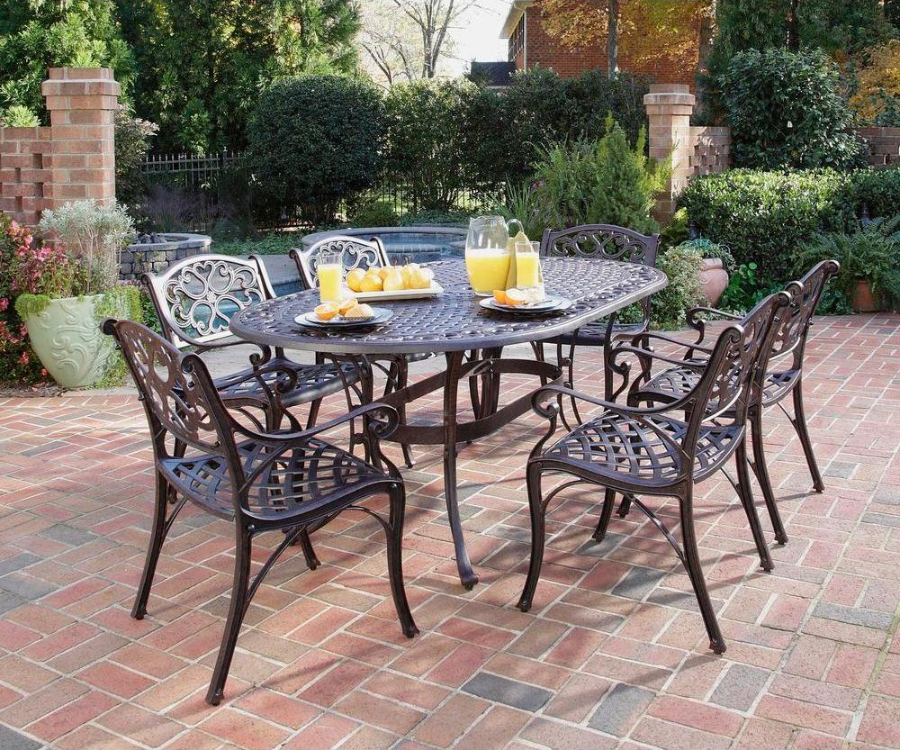 Home styles biscayne 7 piece cast aluminum outdoor dining for Patio table set