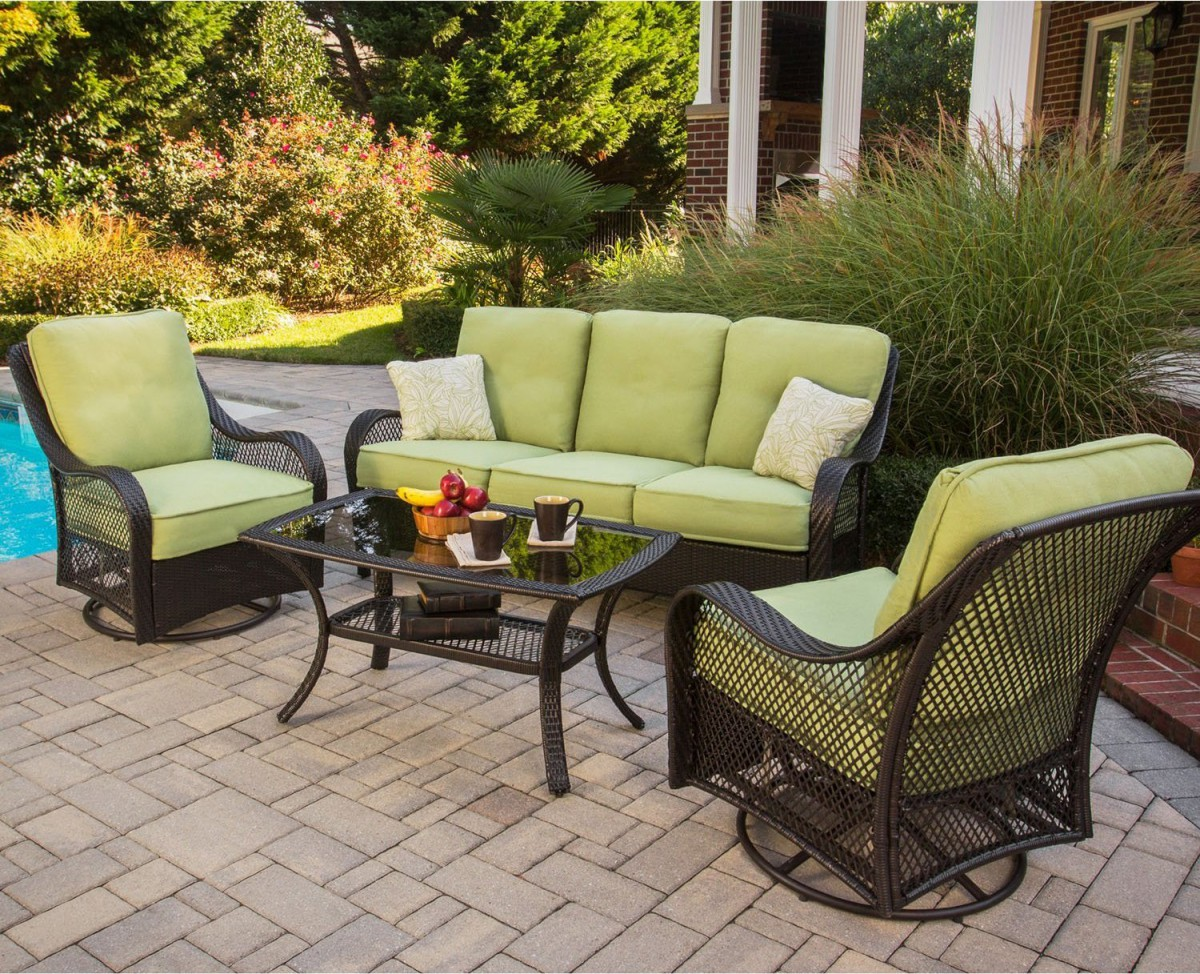 Hanover orleans 4 piece outdoor conversation set with for Outdoor furniture images